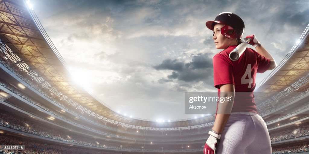 Softball female player on a professional arena : Stock Photo