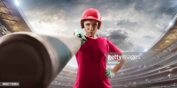 softball female player on a professional arena - sports bat stock pictures, royalty-free photos & images
