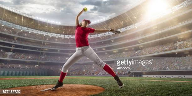 softball female player on a professional arena - softball stock pictures, royalty-free photos & images