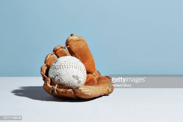 softball glove and ball - richard drury stock pictures, royalty-free photos & images