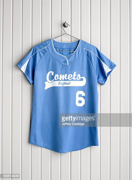 softball jersey on coat hanger - sports jersey stock pictures, royalty-free photos & images