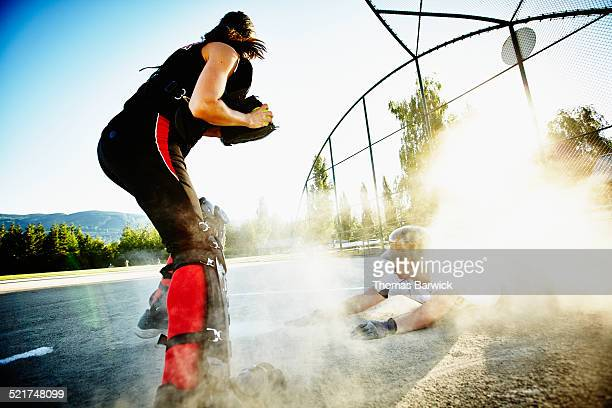 softball player on ground after being tagged out - home base sports stock pictures, royalty-free photos & images
