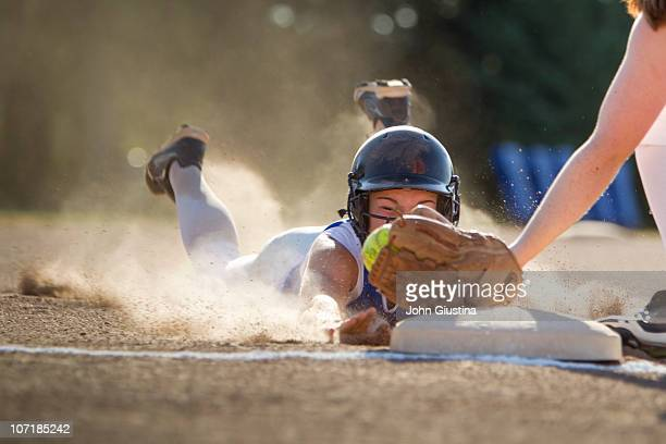 softball player slides head first. - softball sport stock pictures, royalty-free photos & images