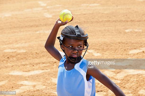 softball player throwing ball - face guard sport stock pictures, royalty-free photos & images