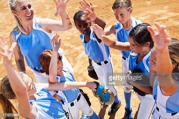 Softball players and coach doing team cheer