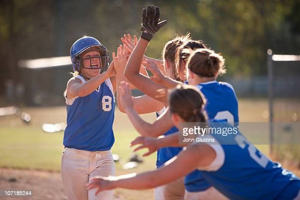 softball players celebrate. - softball sport stock pictures, royalty-free photos & images
