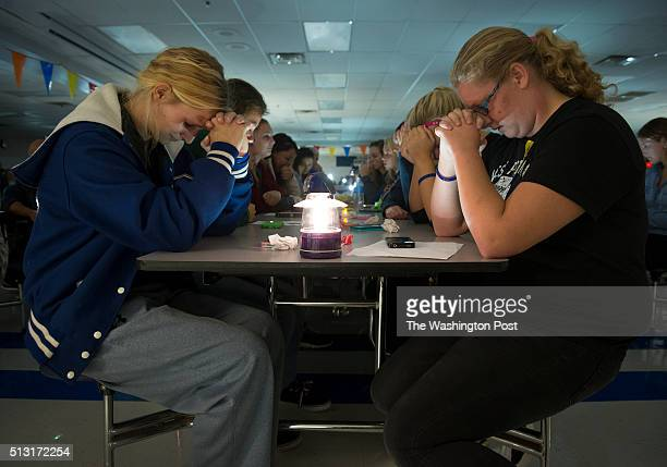 Softball players Olivia Manous Torie Bolger and fellow students observe a moment of silence at a virtual candlelight vigil for missing Univ of...