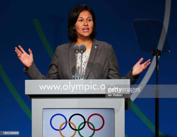 Softball star Maria Soto speaks during a World Baseball Softball Confederation presentation during the 125th IOC Session New Sport Announcement at...