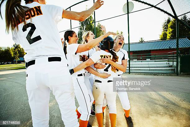 Softball team celebrating after winning game