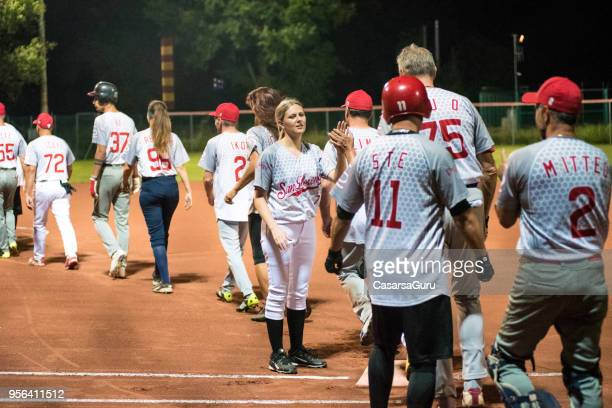 softball team preparing for game - softball stock pictures, royalty-free photos & images