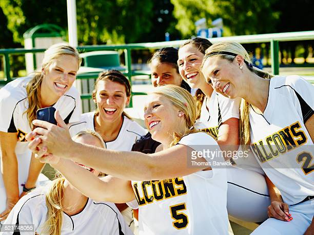 Softball team taking self portrait with smartphone