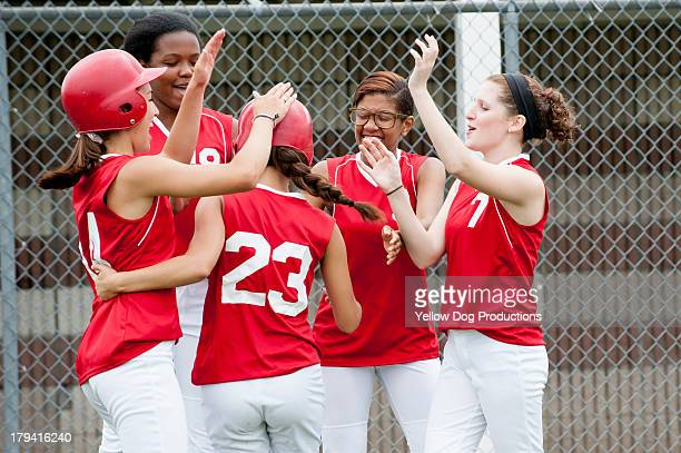 softball teammates cheering together - softball sport stock pictures, royalty-free photos & images