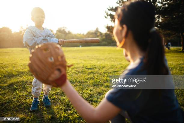 softball training with my mom - baseball mom stock pictures, royalty-free photos & images