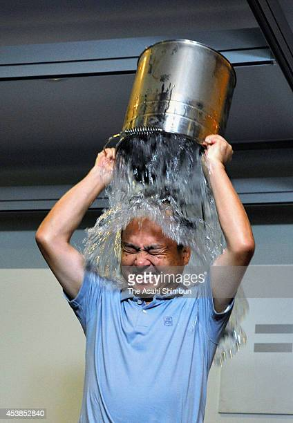SoftBank CEO Masayoshi Son pours water for the Ice Bucket Challenge to raise awareness for amyotrophic lateral sclerosis on August 20 2014 in Tokyo...