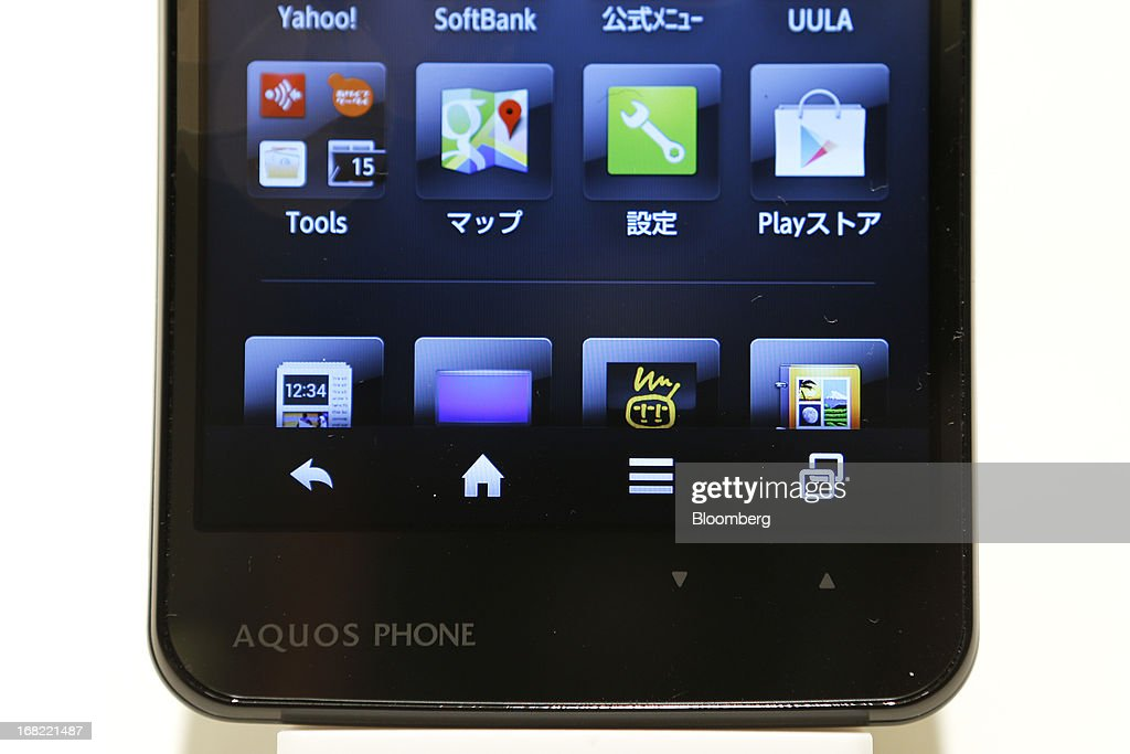 A SoftBank Corp. Aquos Phone Xx 206SH smartphone, manufactured by Sharp Corp., is displayed during a product launch in Tokyo, Japan, on Tuesday, May 7, 2013. SoftBank President Masayoshi Son will visit the U.S. to meet with Sprint Nextel Corp. institutional investors to discuss the company's proposed takeover, SoftBank spokesman Mitsuhiro Kurano said today. Photographer: Kiyoshi Ota/Bloomberg via Getty Images