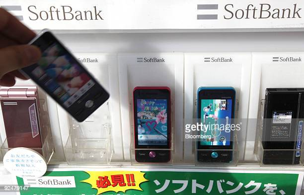 Softbank Corp. Mobile phones are displayed at an electronics store in Tokyo, Japan, on Thursday, Oct. 29, 2009. Softbank, Japan's third-largest...