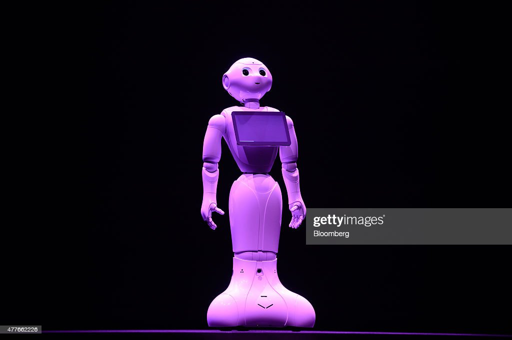 SoftBank Corp.'s humanoid robot Pepper is demonstrated during a news conference in Urayasu, Chiba Prefecture, Japan, on Thursday, June 18, 2015. SoftBank will start sales of its Pepper robot to consumers Saturday in a bid to spur adoption. Photographer: Akio Kon/Bloomberg via Getty Images