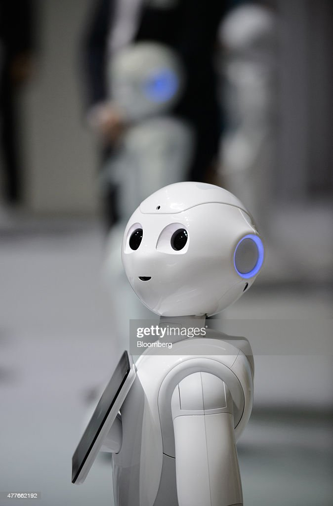 SoftBank Corp.'s humanoid robot Pepper stands during a news conference in Urayasu, Chiba Prefecture, Japan, on Thursday, June 18, 2015. SoftBank will start sales of its Pepper robot to consumers Saturday in a bid to spur adoption. Photographer: Akio Kon/Bloomberg via Getty Images