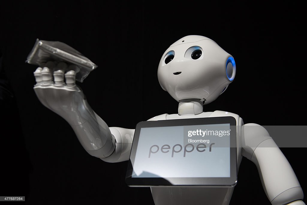 SoftBank Corp.'s Pepper humanoid robot stands during a news conference in Urayasu, Chiba Prefecture, Japan, on Thursday, June 18, 2015. SoftBank will start sales of its Pepper robot to consumers Saturday in a bid to spur adoption. Photographer: Akio Kon/Bloomberg via Getty Images