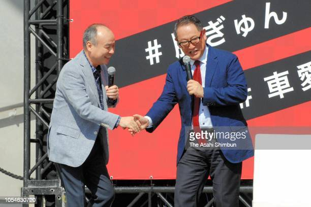 SoftBank Group CEO Masayoshi Son and Toyota Motor Co President Akio Toyoda shake hands during a talk show of the Tokyo Motor Fes 2018 at DiverCity...