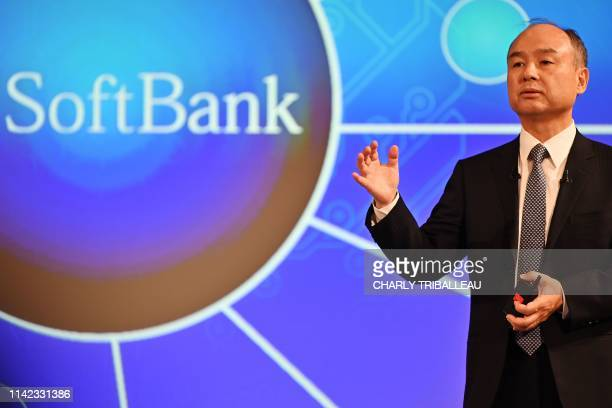 Softbank Group CEO Masayoshi Son delivers a speech during his company's financial results press conference at a hotel in Tokyo on May 9 2019 Japan's...