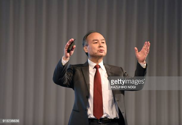 SoftBank Group Corp Chairman and CEO Masayoshi Son gestures as he delivers a speech during a press briefing to announce the company's financial...
