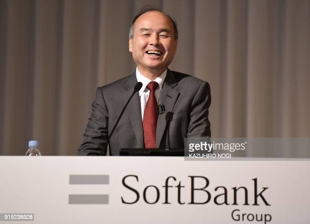 SoftBank Group Corp Chairman and CEO Masayoshi Son smiles as he answers questions during a press briefing to announce the company's financial results...