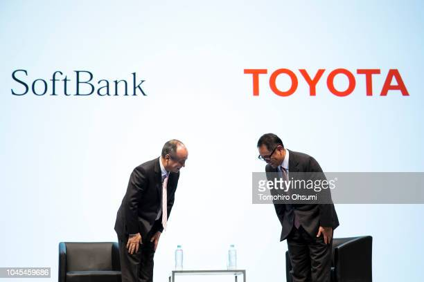 SoftBank Group Corp Chairman and Chief Executive Officer Masayoshi Son and Toyota Motor Corp President Akio Toyoda bow during a joint press...