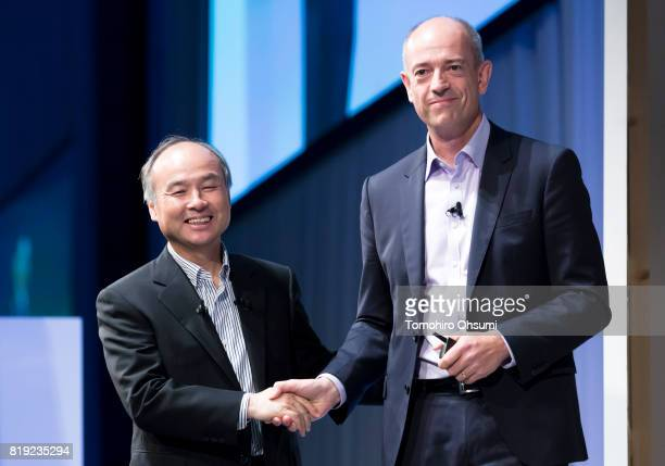 SoftBank Group Corp. Chief Executive Officer Masayoshi Son, left, shakes hands with ARM Holdings Plc Chief Executive Officer Simon Segars during the...