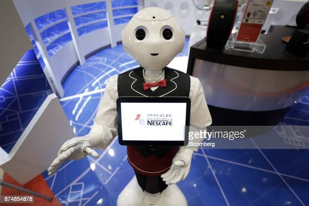 A SoftBank Group Corp Pepper humanoid robot stands during a media preview of the humanless cafe inside Nestle SA's Nescafe coffee shop in the...