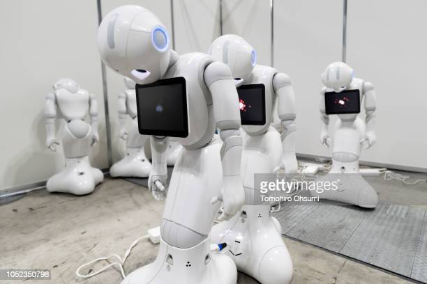 SoftBank Group Corp. Pepper humanoid robots are charged during the World Robot Challenge competition held as part of the World Robot Summit on...