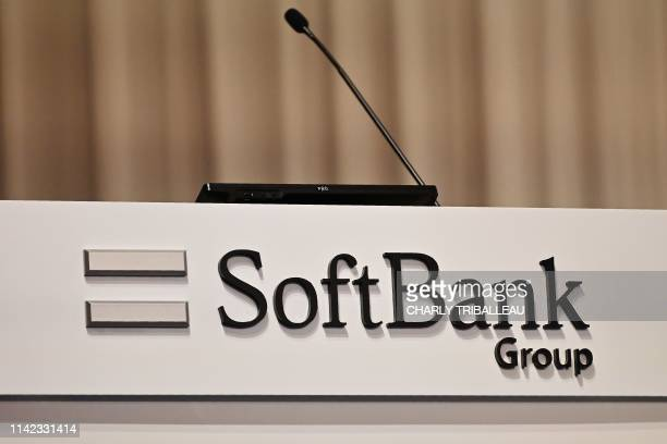 A Softbank Group logo is seen during the company's financial results press conference at a hotel in Tokyo on May 9 2019 Japan's SoftBank Group on May...