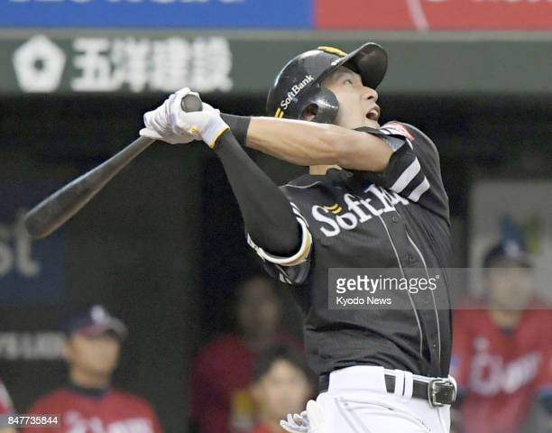 SoftBank Hawks cleanup hitter Yuki Yanagita hits a tworun homer during the fourth inning of a game against the Seibu Lions at MetLife Dome outside...