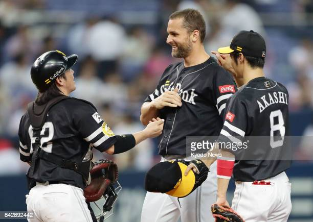 SoftBank Hawks closer Dennis Sarfate is congratulated by teammates after picking up a Japanese singleseason record 47th save in a 65 win over the...