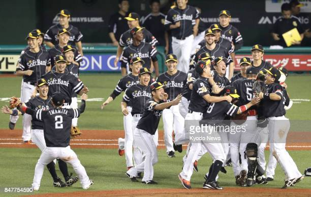SoftBank Hawks players celebrate as they won their first Pacific League pennant in two seasons on Sept 16 by beating the Seibu Lions 73 at MetLife...