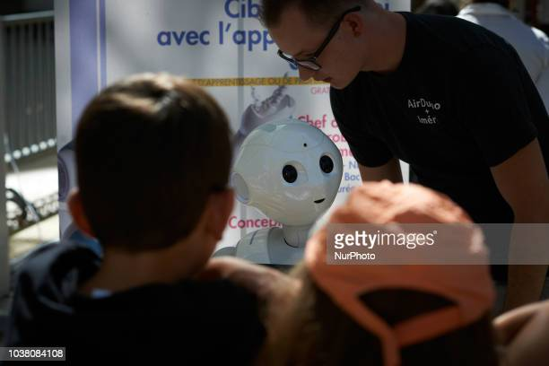 A SoftBank robot speaks with children A robots race took place in Toulouse Machines are either cars or walking robots They were supposed to run a 110...