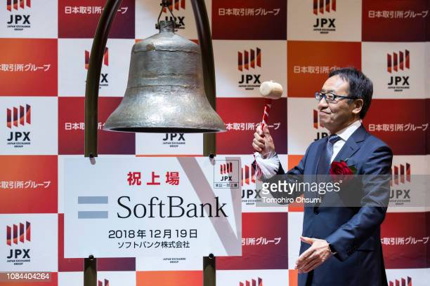 SoftBankCorp Chief Executive Officer Ken Miyauchi hits a bell during a ceremony for the company's listing at the Tokyo Stock Exchange on December 19...