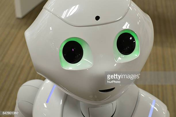 SoftBank's humanoid robot Pepper performs during a Softbank phone store in Tokyo Japan on June 25 2016