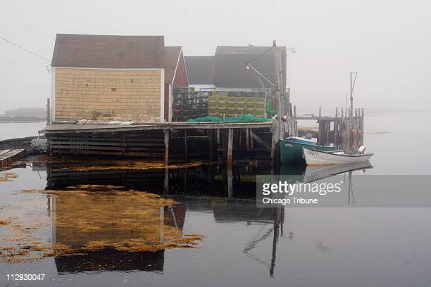 Softened by fog boats shacks and water is the combination for a classic Nova Scotia portrait in the village of Blue Rocks near Lunenburg