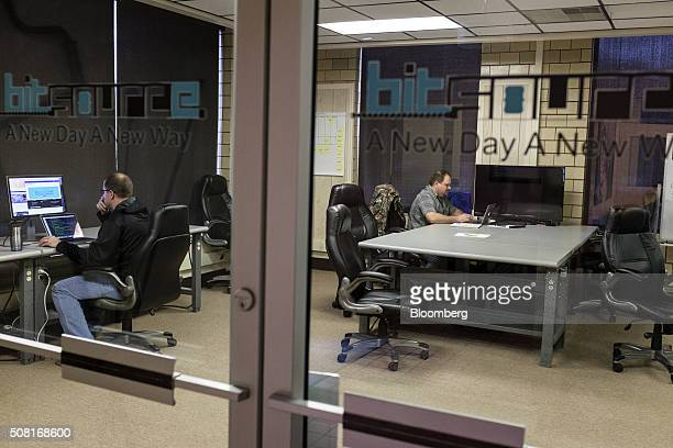 Software coders Jim Ratliff, left, and J. Paul Gorman work at the Bit Source LLC office in Pikeville, Kentucky, U.S., on Monday, Feb. 1, 2016. Bit...