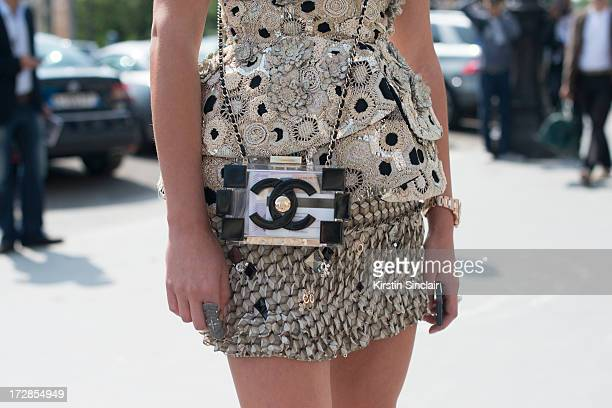 Software Designer Inga Kozel wears a Chanel bag Alexander Mcqueen couture top Josef Statkus skirt on day 2 of Paris Collections Womens Haute Couture...