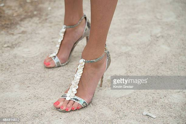 Software designer Inga Kozel wears Balmain shoes son day 3 of Paris Fashion Week Haute Couture Autumn/Winter 2015 on July 7 2015 in Paris France
