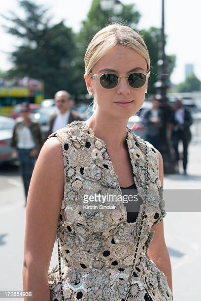 Software Designer Inga Kozel wears Moscat sunglasses Alexander Mcqueen couture top on day 2 of Paris Collections Womens Haute Couture on July 02 2013...