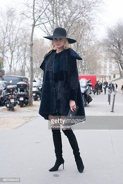 Software Developer Enya Kazel wears a Chanel hat Dior coat Hermes handbag and skirt by Josef Statkus on day 2 of Paris Haute Couture Fashion Week...