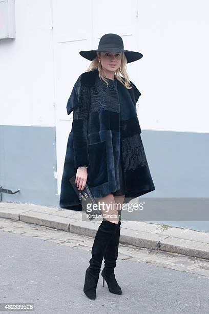 Software Developer Enya Kazel wears a Chanel hat Dior coat Hermes handbag and skirt by Josef Statkus on day 2 of Paris Haute Couture Fashion Week...
