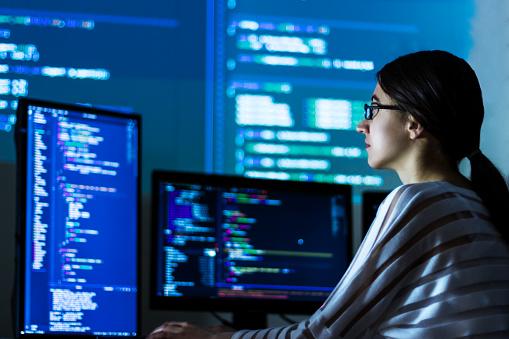 Software developer freelancer woman working at night 1173805290