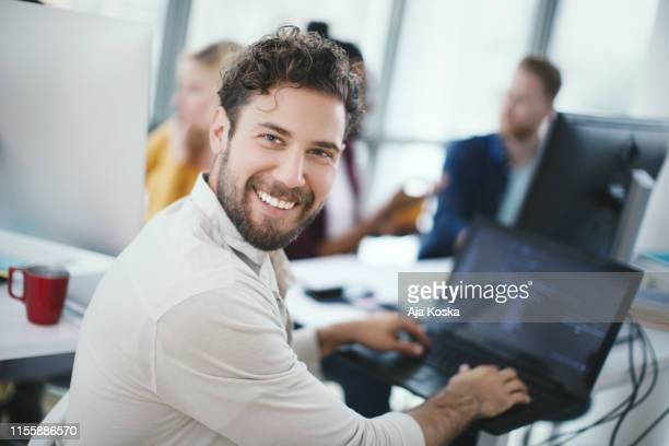 software developer working at office. - looking over shoulder stock pictures, royalty-free photos & images