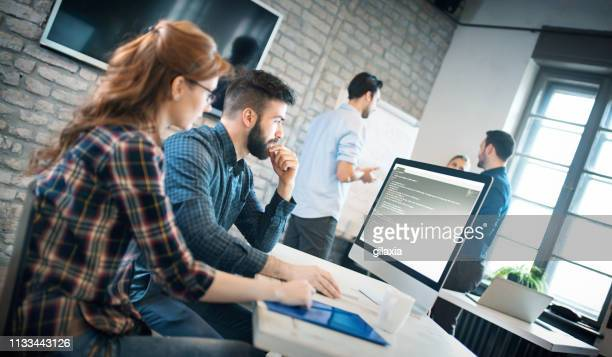 software developers at work - smart casual stock pictures, royalty-free photos & images