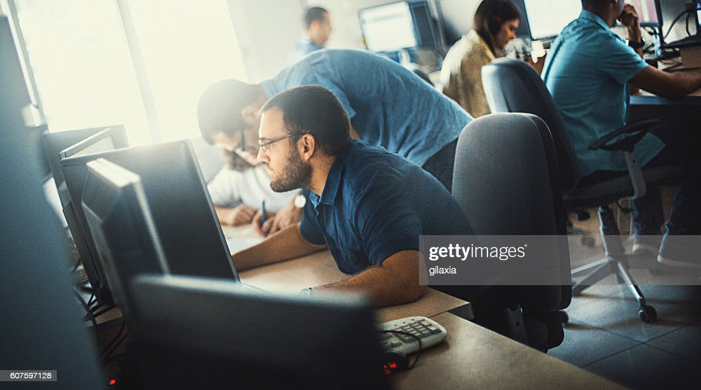 Software developers at work. : Stock Photo