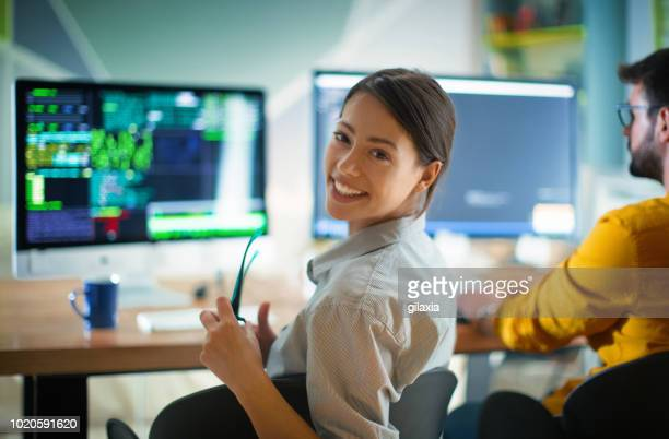 software developers doing some research. - programmer stock pictures, royalty-free photos & images
